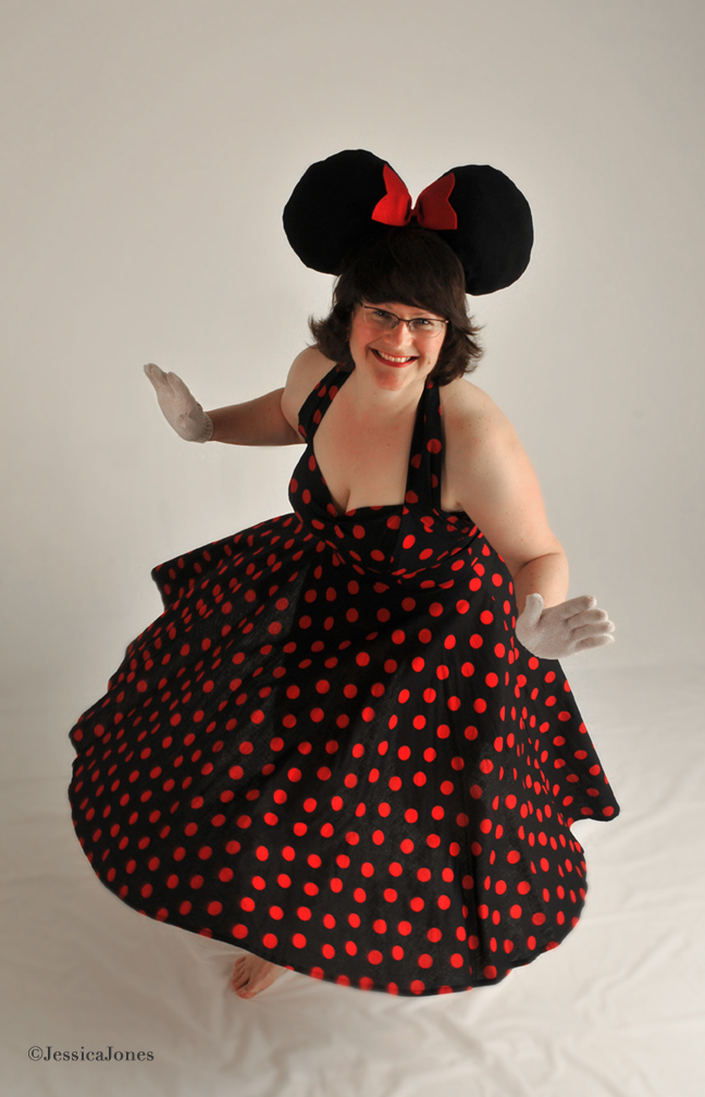 Photo of Colleen in black and red polka-dot dress